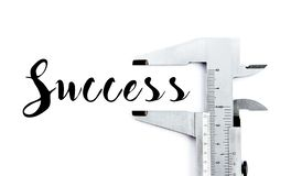 Measuring success word with caliper. Isolated royalty free stock images
