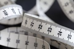 Measuring tailor tape. Closeup, macro. On numbers, industrial concept Royalty Free Stock Image