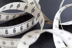Measuring tailor tape. Closeup, macro. On numbers, industrial concept Stock Photos