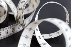 Measuring tailor tape. Closeup, macro. On numbers, industrial concept Stock Photography