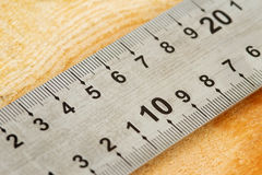 Measuring tape 1. Closeup of a measuring tape on a wooden background Royalty Free Stock Images