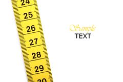 Measuring tape. Close up of a measuring tape, isolated on a white background royalty free stock photos