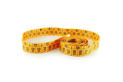 Measuring tape. On a white background Royalty Free Stock Image