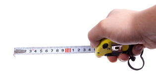 Measuring tape. In hand on a white background Stock Photography