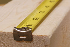 Measuring tape. Lined up ready to measure piece of wood Stock Images