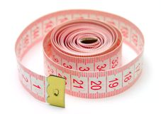 Measuring tape. On the white background Royalty Free Stock Photo
