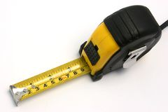Measuring tape 2. A measuring tape on white background Royalty Free Stock Photos