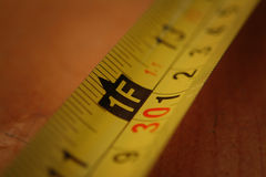 Measuring Tape. Close up of the one foot mark on a measuring tape stock images