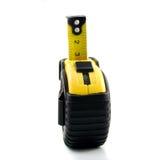 Measuring tape. Yellow measuring tape on black rubberized case Stock Photo