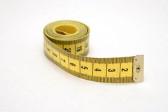 Measuring tape. Isolated measuring tape over a white background royalty free stock photography