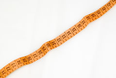 Measuring tape. Strached measuring tape. It is Royalty Free Stock Images