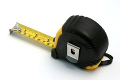 Measuring tape. A measuring tape on white background Royalty Free Stock Photography