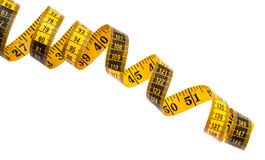 Measuring Tape. Yellow measuring tape on a white background Stock Photography