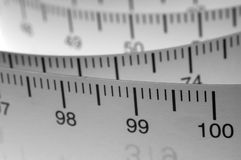Measuring Tape. Showing the metric centimeter side. Landscape B/W version Royalty Free Stock Photo