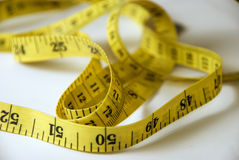 Measuring Tape. Yellow measuring tape unrolled randomly Royalty Free Stock Images