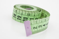 Measuring tape. Green measuring tape isolated on white background Royalty Free Stock Photo