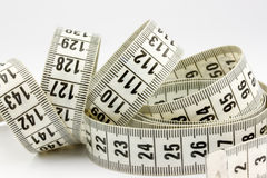 Measuring tape. On light background Stock Photos