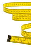 Measuring tape. Yellow measuring tape isolated on white background Stock Image