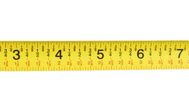Measuring Tape. Close up shot of a yellow measuring tape Stock Photo