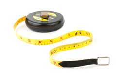 Measuring Tape. Measuring yellow tape tool ower white background Royalty Free Stock Photo