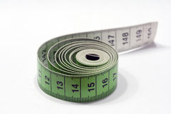 Measuring tape. With white background Stock Photography