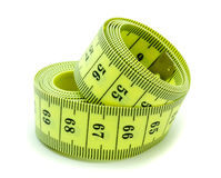 Measuring tape. A coiled yellow measuring tape on white background Stock Images