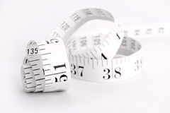 Measuring tape. Curled up measuring tape, shallow depth of field stock photos