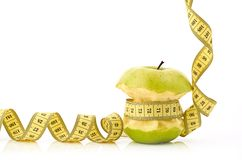 Measuring Tape And Apple Royalty Free Stock Photography