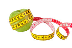 Measuring tape and apple Stock Photos