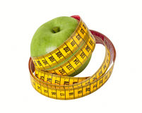 Measuring tape and apple Royalty Free Stock Images