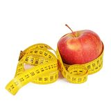 Measuring tape with apple isolated Stock Images