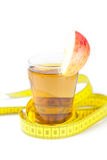 Measuring tape,apples and glass of apple juice Royalty Free Stock Images