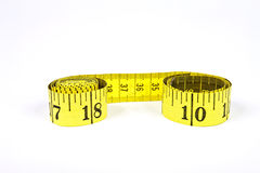 Measuring tape with applications in tailoring in yellow and blac Stock Photos