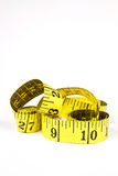 Measuring tape with applications in tailoring in yellow and blac Stock Images
