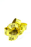 Measuring tape with applications in tailoring in yellow and blac Stock Image