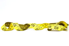Measuring tape with applications in tailoring in yellow and blac Stock Photo
