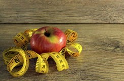 Measuring tape around apple Stock Photo