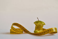 Measuring tape around green apple core Royalty Free Stock Photography