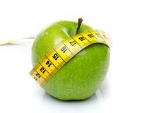 Measuring tape around a green apple Royalty Free Stock Images