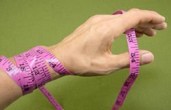 Measuring Tape Around Hand Royalty Free Stock Photography