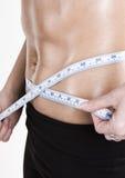 Measuring tape around slim beautiful waist Stock Photos