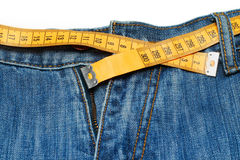 Measuring tape around trousers Royalty Free Stock Photos