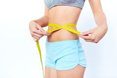 Measuring tape around waist royalty free stock photo