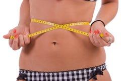 Measuring tape around woman's waist. Diet concept Stock Photos