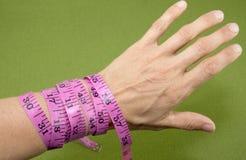 Measuring Tape Around Wrist Royalty Free Stock Photo