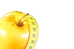 Measuring tape around yellow apple with space for text, diet concept Stock Photography