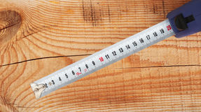 Measuring tape. On the background of wooden boards Royalty Free Stock Image