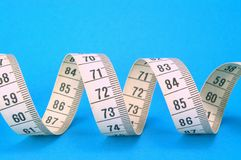 Measuring Tape on Blue Stock Image