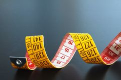 Measuring tape on blue background Royalty Free Stock Photos