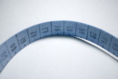 Measuring tape. Blue Royalty Free Stock Photos